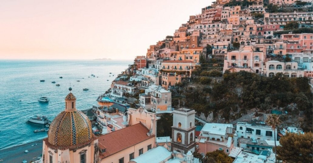 Candy coloured houses on a hill by the ocean, on the Amalfi Coast.